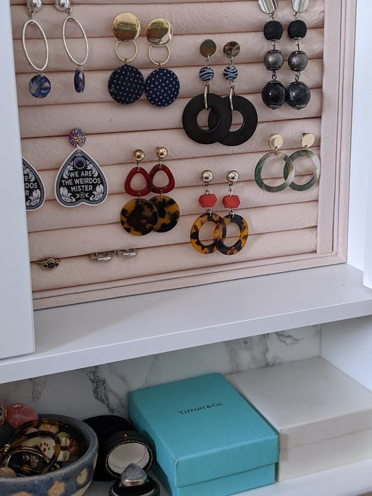 earrings in a holder