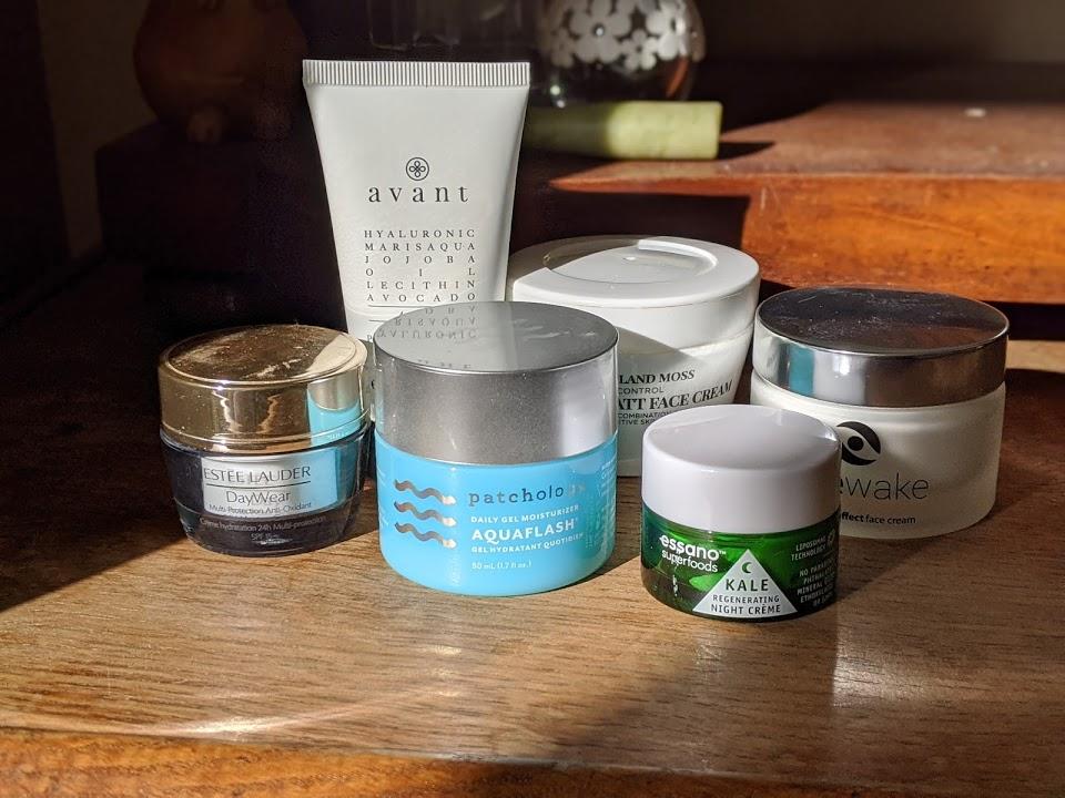 jars of moisturiser on a table